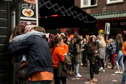 Participants of the King's Day celebration kiss in Leidseplein, Amsterdam. Over a million people gathered on April 27 to honour Willem-Alexander's birthday. Isabel Bonnet / Staff